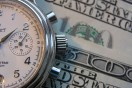 hourly payroll symbols - a stopwatch and paper money