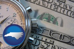 north-carolina map icon and hourly payroll symbols - a stopwatch and paper money