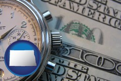 north-dakota map icon and hourly payroll symbols - a stopwatch and paper money