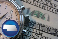 nebraska map icon and hourly payroll symbols - a stopwatch and paper money