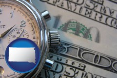 south-dakota map icon and hourly payroll symbols - a stopwatch and paper money