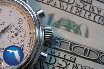 hourly payroll symbols - a stopwatch and paper money - with Florida icon