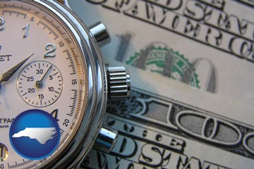 hourly payroll symbols - a stopwatch and paper money - with North Carolina icon