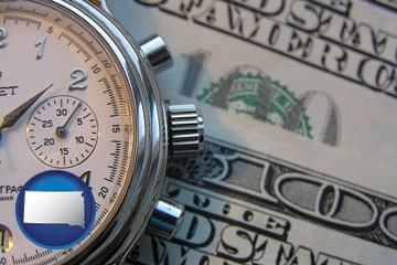 hourly payroll symbols - a stopwatch and paper money - with South Dakota icon
